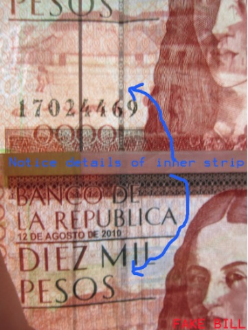NOTICE THE LACK OF DETAIL CUT INTO THE SECURITY STRIP OF THE FAKE NOTE.