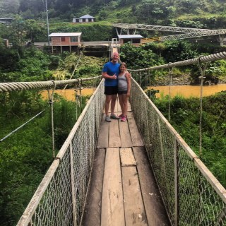 My friend and daughter crossing the suspension bridge.